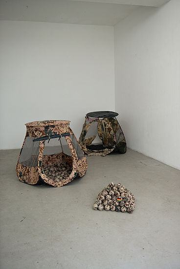 Down to earth  nylonfabric, plasticballs, fabric of armyshirts 2 pieces each 120 cm x 90 cm, 2010